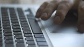 Hands typing on the keyboard. Man typing. wooden background. Hands typing on the keyboard. Man typing. Dolly, locked down, close-up, day, indoors. Male typing on stock video footage