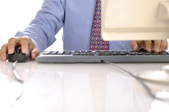 Hands Typing On Keyboard Stock Image