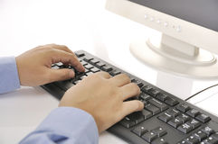 Hands Typing On Keyboard Stock Photos