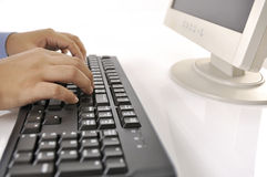 Hands Typing On Keyboard Stock Photo