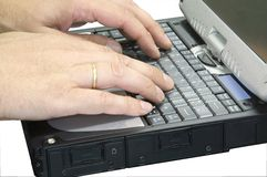 Hands typing on laptop Royalty Free Stock Photography