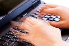Hands typing on a laptop Stock Photo