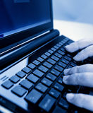 Hands typing on a laptop Stock Images