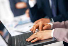 Hands Typing On the Laptop. Closeup picture of businesswoman's hands typing on the laptop Royalty Free Stock Photography