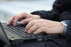 Hands typing on laptop Royalty Free Stock Images