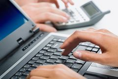 Hands typing on a laptop Royalty Free Stock Images