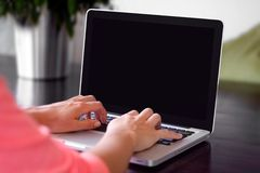 Hands typing on laptop Royalty Free Stock Image