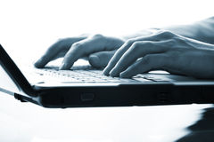 Hands typing on a laptop Royalty Free Stock Photo