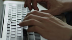 Hands typing on laptop. Close-up top view of man's hands typing on laptop stock video footage