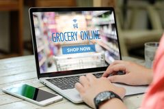 Hands typing laptop computer with grocery shopping online on scr. Een background, business and technology, lifestyle concept royalty free stock photo