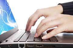 Hands typing on laptop keyboard Stock Images