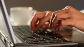 Hands typing. On a laptop keyboard stock footage