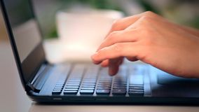 Hands typing on a laptop keyboard Stock Photography
