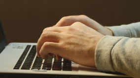 Hands typing on a laptop keyboard.  stock video