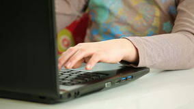 Hands typing on laptop keyboard. Hands typing on black laptop keyboard stock footage