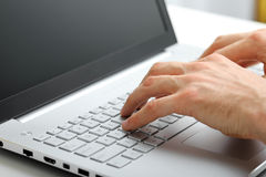 Hands typing on laptop keyboard Stock Photography