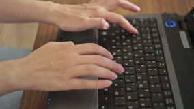 Hands typing on a laptop keyboard stock video footage