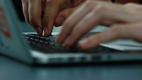 Hands typing on a laptop keyboard. Laptop keyboard typing. Hands touch typing on a laptop keyboard stock photos