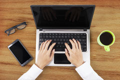 Hands typing on laptop in office Royalty Free Stock Images