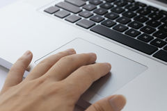Hands typing on a laptop track pad Royalty Free Stock Photos
