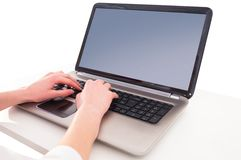 Hands typing on laptop. On white background Royalty Free Stock Photos
