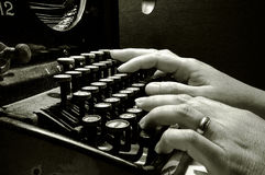 Hands typing on old typewriter keyboard Royalty Free Stock Images