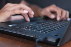 Free Hands Typing On Black Laptop Keyboard. Young Man Doing Business Or Homework By Searching, Browsing Information From Internet. Stock Photos - 162889733
