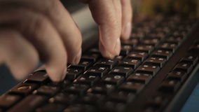 Hands typing on the remote computer keyboard 2. Hands typing on the remote wireless computer keyboard in an office stock video