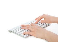 Hands typing on the remote wireless computer keyboard Stock Photography