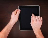 Hands typing on tablet Royalty Free Stock Photo