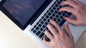 Hands typing on tablet financial information. HD stock footage