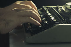 Hands typing with typewriter. Vintage filtered Stock Photos