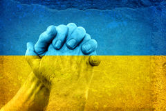 Hands on Ukrainian Flag Royalty Free Stock Image
