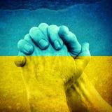 Hands on Ukrainian Flag Royalty Free Stock Photo
