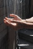 Hands Under Falling Water Royalty Free Stock Images