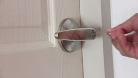 Hands Unlock House Door To Enter stock footage