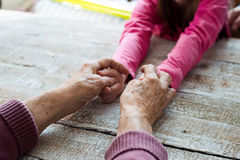 Hands of unrecognizable grandmother and her granddaughter Royalty Free Stock Photography