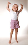 Hands up. Isolated jumping girl Royalty Free Stock Image