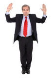 Hands up. Business man on full suit with hands up isolated on white background stock photo