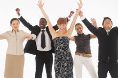 Hands up. A group of young, international businesspeople standing together being happy Stock Photography