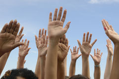 Hands Up against blue sky Royalty Free Stock Photos