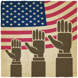 Hands up on American flag old background Royalty Free Stock Photography