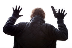 Hands up with gun. A man with a gun holding his hands up Royalty Free Stock Photos
