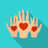 Hands up with hearts icon in flate style isolated on white background. Charity and donation symbol stock vector Royalty Free Stock Photography