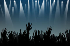 Hands up silhouettes at a concert Stock Photos