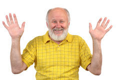 Hands up, smiling senior bald man. With mirror, bad teeth Stock Photo