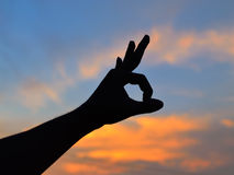Hands up at sunset Royalty Free Stock Photography