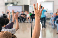Hands up for vote on meeting blurred background.  Royalty Free Stock Photos