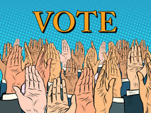 Hands up voting for the candidate Stock Photos