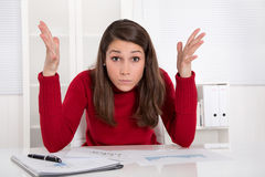 Hands up - young businesswoman has concentration problems at stu Royalty Free Stock Image